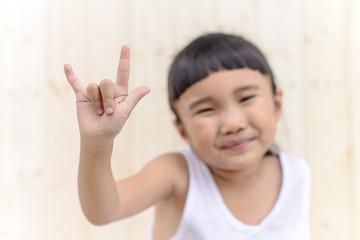 Kid with hand posture