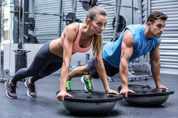 Young bodybuilder training with a young woman