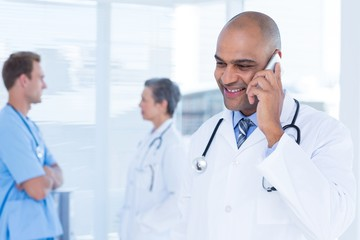 Smiling doctor talking on the phone