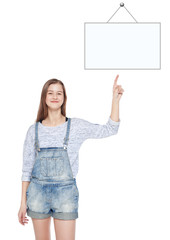 Young teenage girl showing on empty picture frame by finger