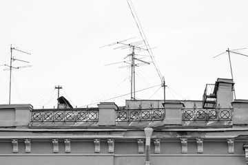 old house with chimneys and television antennas