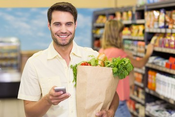 Portrait of handsome man buying food products