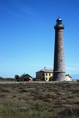 Skagen's Grey Lighthouse under blue sky, Denmark
