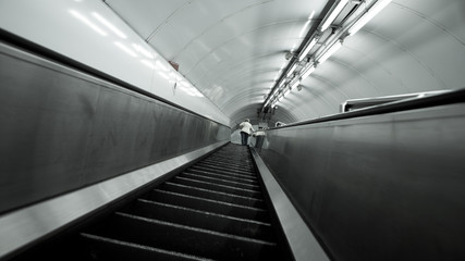 London Underground escalator. An abstract, low and wide angle view up the escalators deep within the London Underground transport network.