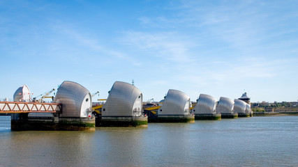 Thames Barrier, London. The contemporary architecture of the London flood barrier which crosses the River Thames between Silvertown and New Charlton.
