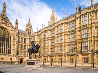 Houses of Parliament, London. The walls of the UK seat of government, The Houses of Parliament, a classic example of gothic architecture.