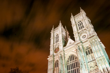 . A low angle view looking up at the façade of Westminster Abbey, Westminster, London.  An ultra long exposure blurs the night sky clouds into an abstract blur.Westminster Abbey, London
