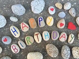 Happy Birthday on carved pebbles