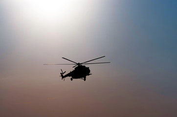 silhouette of the helicopter at dusk