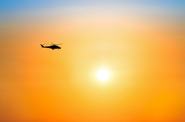 Helicopter flying in the beautiful sky