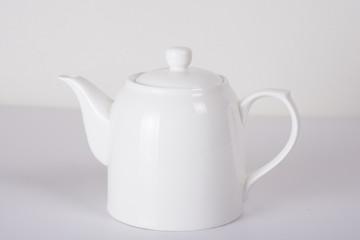 white ceramic teapot on white background