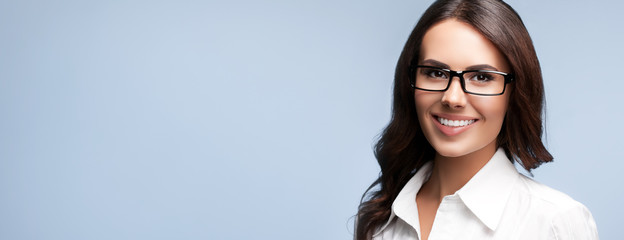 young cheerful businesswoman in glasses, with copyspace