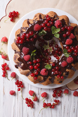 Delicious cake with fresh berries and chocolate glaze close-up. top view