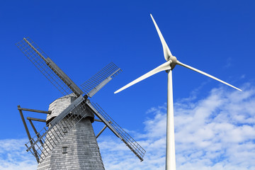 Old  and modern windmills against the blue sky