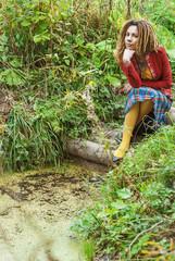 woman with dreadlocks near marshes.