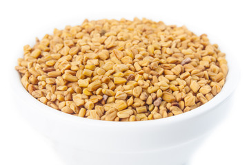 Fenugreek seeds in white bowl