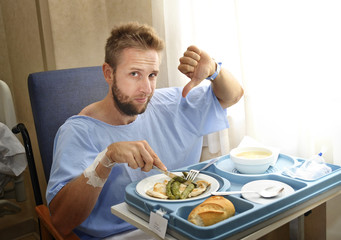 moody face patient in hospital room eating healthy diet clinic food upset