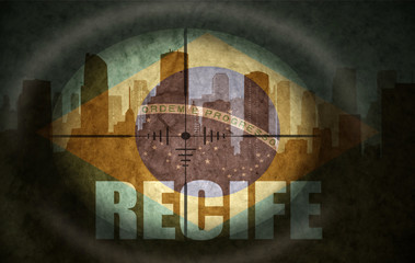 sniper scope aimed at the abstract silhouette of the city with text Recife at the vintage brazilian flag