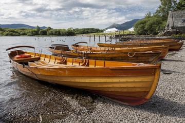 Rowing Boats on banks of Derwent Water, at Keswick, English Lake District. Cumbria, England, UK.