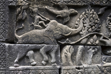 Angkor Wat sculptural relief in stone of ancient stylized elephant with warrior riding his back