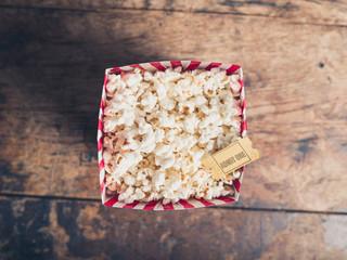 Popcorn and cinema ticket