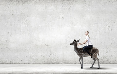 Wall Mural - Woman ride deer
