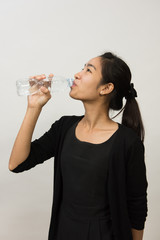 Young women businessman drinking water on the white background.
