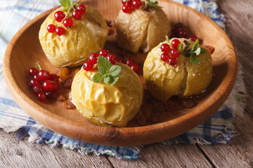 baked apples with honey, mint and red currant close up horizontal