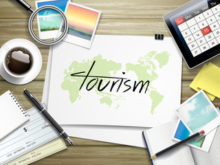 tourism word written on paper