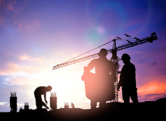 Silhouette engineer looking construction worker under tower cran