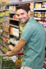 Portrait of smiling man pusching his trolley