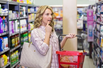 Side view of a pretty blonde woman with a shopping bag