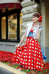 Young girl pin-up style walking at the street