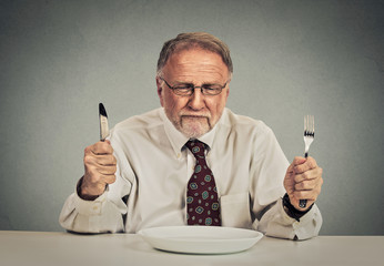businessman with empty plate knife and fork ready for deal negotiation