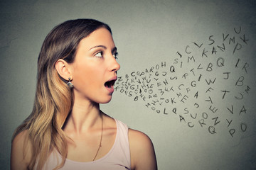 Woman talking with alphabet letters coming out of her mouth