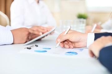 Business adviser analyzing financial figures