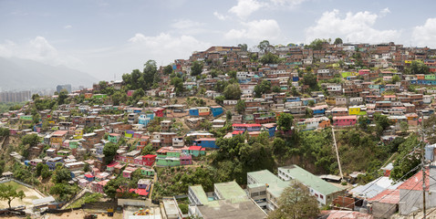 Slum district of Caracas with small wooden coloured houses