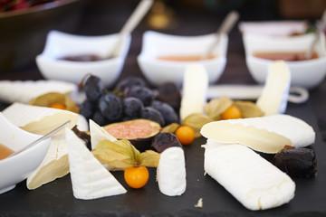 set of ingredients: cheese, olives, berries, sauces, snacks