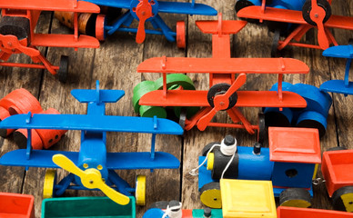 Handmade wooden toys on a wooden base
