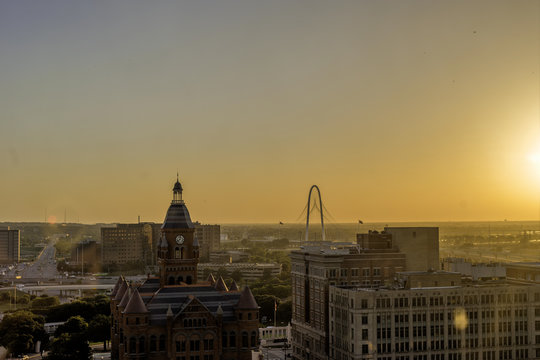 Dallas' West End Historic District and the Margaret Hunt Hill Bridge at sunset