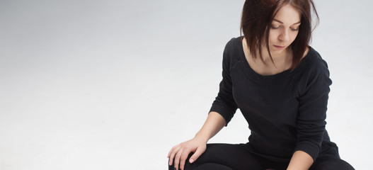 young beautiful woman sitting in lotus position, copy space