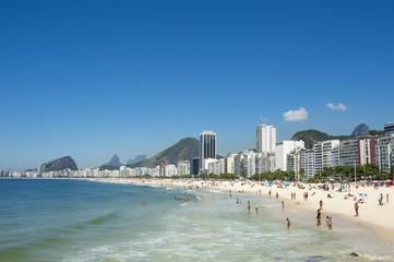 Scenic view of Copacabana Beach shore with skyline of Rio de Janeiro Brazil