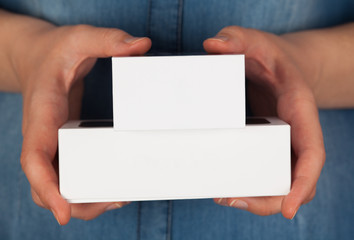 Two boxes in woman hands