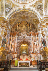 GRANADA, SPAIN - MAY 29, 2015: The presbytery and main altar of baroque church Nuestra Senora de las Angustias designed by sculptor Pedro Duque Cornejo from 17. cent.