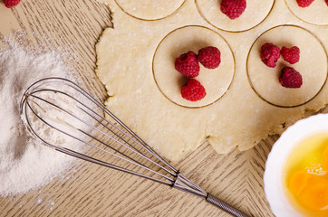 cooking biscuits, cakes with raspberries, roll raw dough