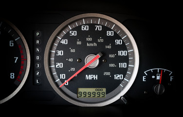 Car dashboard odometer with 999999 miles on it