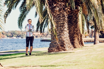 Healthy lifestyle young sporty woman having break between palm