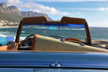Blue classic car on the beach
