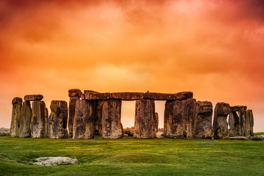 Stonehenge against fiery orange sunset sky
