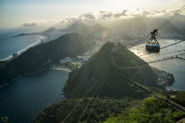 Sunset view of Sugarloaf Pao de Acucar Mountain Rio de Janeiro Brazil cable car city skyline